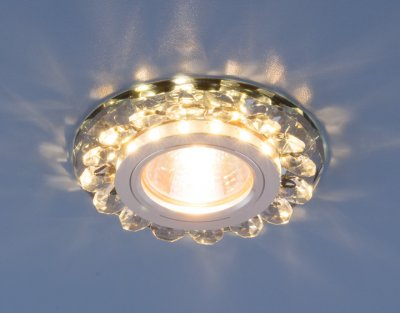 6036 MR16 Gr дымчатый Электростандарт Точечный светодиодный светильник с хрусталемВстраиваемые хрустальные светильники<br>Точечные светильники Elektrostandard™ предназначены для жилых и общественных помещений. Светильник подходит для всех типов подвесных потолков: гипсокартонных, натяжных и реечных. Cветильники оснащены светодиодной подсветкой, которая может быть включена как совместно с лампой, так и отдельно. Мягкий свет от светодиодов создает идеальную атмосферу для отдыха или просмотра телевизора.<br> Лампа: MR16 G5.3 max 50 Вт + LED Мощность LED подсветки: 3 Вт Диаметр: ? 90 мм Высота внутренней части: ? 20 мм Высота внешней части: ? 15 мм Монтажное отверстие: ? 70 мм Гарантия: 2 года<br><br>Тип цоколя: gu5.3<br>Диаметр, мм мм: 90<br>Диаметр врезного отверстия, мм: 70<br>Высота, мм: 15<br>MAX мощность ламп, Вт: 50