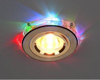 2020/2 GD/7-LED (золото / мультиколор) Электростандарт Точечный светильник для натяжных, подвесных и реечных потолковКруглые LED<br>В корпусе светильника вмонтированы плавно переливающиеся всеми цветами радуги светодиоды. Лампа: MR16 G5.3 max 35 Вт + LED Мощность LED подсветки: 1 Вт Диаметр: ? 96 мм Высота внутренней части: ? 12 мм Высота внешней части: ? 12 мм Монтажное отверстие: ? 60 мм Гарантия: 2 года<br><br>S освещ. до, м2: 2<br>Тип лампы: галогенная<br>Тип цоколя: gu5.3<br>Цвет арматуры: Золотой<br>Диаметр, мм мм: 91<br>Диаметр врезного отверстия, мм: 65<br>Оттенок (цвет): разноцветный<br>MAX мощность ламп, Вт: 50