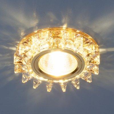 6037 MR16 YL/GD зеркальный/золото Электростандарт Точечный светодиодный светильник с хрусталемВстраиваемые хрустальные светильники<br>Лампа: MR16 G5.3 max 35 Вт + LED Мощность LED подсветки: 3 Вт Диаметр: ? 95 мм Высота внутренней части: ? 18 мм Высота внешней части: ? 15 мм Монтажное отверстие: ? 60 мм Гарантия: 2 года<br><br>Тип цоколя: gu5.3<br>Диаметр, мм мм: 95<br>Диаметр врезного отверстия, мм: 60<br>Высота, мм: 15<br>MAX мощность ламп, Вт: 50