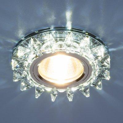 6037 MR16 BL сапфир/хром Электростандарт Точечный светодиодный светильник с хрусталемВстраиваемые хрустальные светильники<br>Лампа: MR16 G5.3 max 35 Вт + LED Мощность LED подсветки: 3 Вт Диаметр: ? 95 мм Высота внутренней части: ? 18 мм Высота внешней части: ? 15 мм Монтажное отверстие: ? 60 мм Гарантия: 2 года<br><br>Тип цоколя: gu5.3<br>Диаметр, мм мм: 95<br>MAX мощность ламп, Вт: 35
