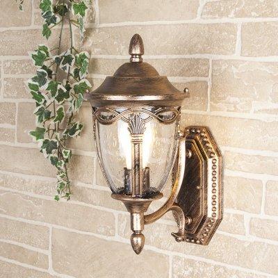 Mensa U черное золото (арт. GLXT-1473U) Электростандарт Настенный светильникУличные настенные светильники<br>Цвет: черное золото Мощность: 1 x 60 Вт  Цоколь: Е27 Питание: 220-240 В / 50 Гц Пылевлагозащита: IP44 Размер: 200 x 260 x 370 мм<br>