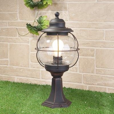 Regul S черная медь (арт. GLXT-1475S) Электростандарт Ландшафтный светильникФонари на столб<br>Цвет: черная медь Мощность: 1 x 60 Вт  Цоколь: Е27 Питание: 220-240 В / 50 Гц Пылевлагозащита: IP44 Размер: 230 x 230 x 575 мм<br>Настенный светильник предназначен не только для внутреннего использования, но и для освещения садово-парковых зон вокруг дома, так как высокая степень пылевлагозащищенности позволяет использовать его под открытым небом.<br>Корпус светильника изготовлен из сплава алюминия с кремнием, что делает его легким и прочным, устойчивым к механическим воздействиям. Специальная порошковая окраска корпуса, наносимая в несколько слоев, позволяет добиться эффекта состаренного металла.<br>Для плафона использовано стекло, изготовленное вручную по технологии pulegoso. Пузырьки воздуха внутри стекла придают светильнику особое, неповторимое, очарование!<br>