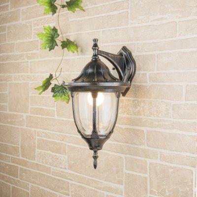 GL 1003D черное золото Электростандарт Светильник уличный настенныйУличные настенные светильники<br>Мощность: 60 Вт Цоколь: Е27 Питание: 220-240 В / 50 Гц Защита: IP 44 Размер: 270 ? 235 ? 465 мм<br><br>Тип лампы: Накаливания / энергосбережения / светодиодная<br>Тип цоколя: E27<br>Количество ламп: 1<br>MAX мощность ламп, Вт: 100