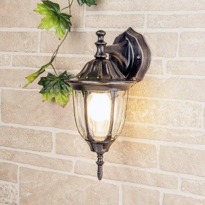 Светильник уличный настенный Elektrostandard GL 1002D черное золотоУличные настенные светильники<br>Мощность: 100 Вт Цоколь: Е27 Питание: 220-240 В / 50 Гц Защита: IP 44 Размер: 205 ? 163 ? 375 мм<br><br>Тип лампы: Накаливания / энергосбережения / светодиодная<br>Тип цоколя: E27<br>Количество ламп: 1<br>MAX мощность ламп, Вт: 60
