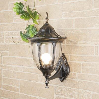 GL 1003U черное золото Электростандарт Светильник уличный настенныйуличные настенные светильники<br>Мощность: 100 Вт Цоколь: Е27 Питание: 220-240 В / 50 Гц Защита: IP 44 Размер: 275 ? 235 ? 465 мм<br><br>Тип лампы: Накаливания / энергосбережения / светодиодная<br>Тип цоколя: E27<br>Количество ламп: 1<br>Ширина, мм: 235<br>Расстояние от стены, мм: 275<br>Высота, мм: 465<br>MAX мощность ламп, Вт: 60