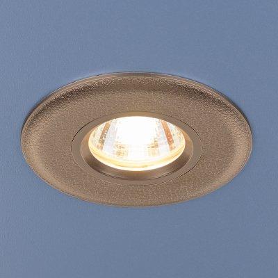 Точечный светильник Elektrostandard 107 MR16 GD золотоКруглые<br>Лампа: MR16 G5.3 max, 35 Вт Диаметр: ? 95 мм Высота внутренней части: ? 25 мм Высота внешней части: ? 5 мм Монтажное отверстие: ? 60 мм Гарантия: 2 года<br><br>Тип цоколя: gu5.3<br>Диаметр, мм мм: 95<br>Диаметр врезного отверстия, мм: 60<br>MAX мощность ламп, Вт: 35