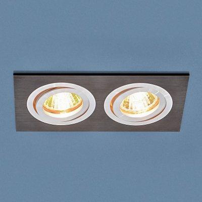 Точечный светильник Электростандарт 1051/2 BK черныйвстраиваемые длинные светильники<br>Лампа: MR16 G5.3 max 50 Вт Размер: 93 х 174 мм Высота внутренней части: ? 25 мм Высота внешней части: ? 3 мм Монтажное отверстие: 75 х 160 мм Гарантия: 2 года Светильник имеет поворотный механизм Корпус из алюминия