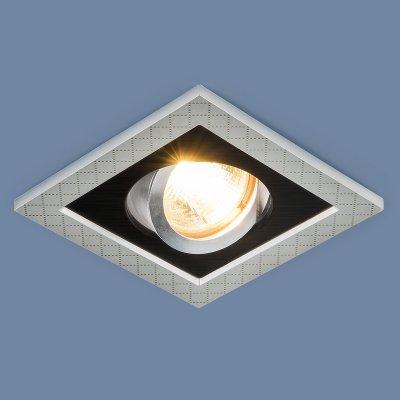 1041/1 MR16 SL/BK серебро/черный Электростандарт Точечный светильник с поворотным механизмомКарданные светильники<br>Лампа: MR16 G5.3 max 50 Вт Размер: 105 х 105 мм Высота внутренней части: ? 23 мм Высота внешней части: ? 5 мм Монтажное отверстие: ?75 мм Гарантия: 2 года Светильник имеет поворотный механизм<br>