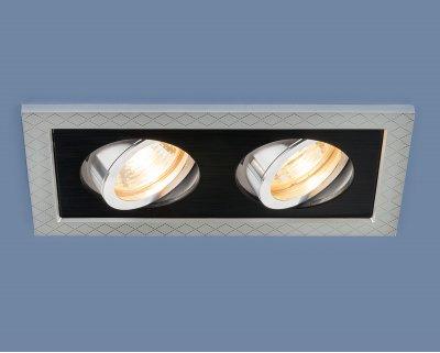 1041/2 MR16 SL/BK серебро/черный Электростандарт Точечный светильник с поворотным механизмомКарданные светильники<br>Лампа: MR16 G5.3 max 50 Вт Размер: 188 х 105 мм Высота внутренней части: ? 23 мм Высота внешней части: ? 5 мм Монтажное отверстие: 155 х 75 мм Гарантия: 2 года Светильник имеет поворотный механизм<br>