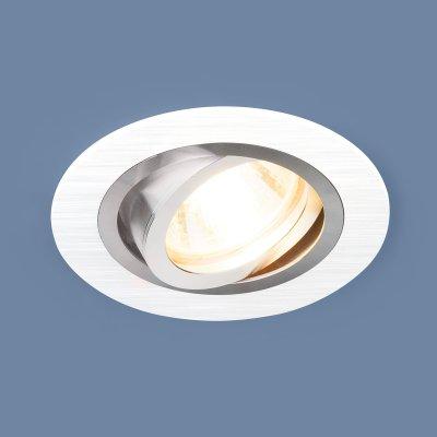 1061/1 MR16 WH белый Электростандарт Алюминиевый точечный светильникКарданные<br>Лампа: MR16 G5.3 max 50 Вт Размер: ?92 мм Высота внутренней части: ? 23 мм Высота внешней части: ? 2 мм Монтажное отверстие: ?75 мм Гарантия: 2 года Алюминиевый корпус Светильник имеет поворотный механизм<br>