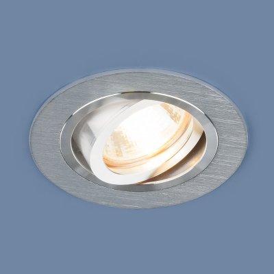 1061/1 MR16 SL серебро Электростандарт Алюминиевый точечный светильникКарданные светильники<br>Лампа: MR16 G5.3 max 50 Вт Размер: ?92 мм Высота внутренней части: ? 23 мм Высота внешней части: ? 2 мм Монтажное отверстие: ?75 мм Гарантия: 2 года Алюминиевый корпус Светильник имеет поворотный механизм<br>