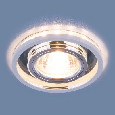 7021 MR16 SL/WH зеркальный/белый Электростандарт Точечный светодиодный светильникКруглые<br>Лампа: MR16, max 35 Вт + LED Мощность LED подсветки: 3 Вт Диаметр: ? 92 мм Высота внутренней части: 11 мм Высота внешней части: 12 мм Монтажное отверстие: ? 60 мм Гарантия: 2 года<br><br>Тип цоколя: MR16<br>MAX мощность ламп, Вт: 35<br>Диаметр, мм мм: 92<br>Диаметр врезного отверстия, мм: 60