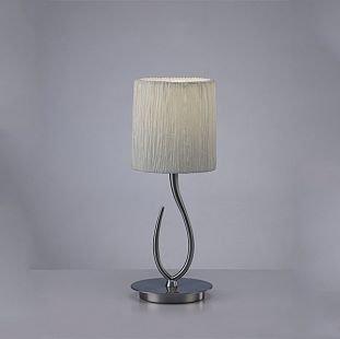 Светильник Mantra 3702 LuaСовременные настольные лампы модерн<br>Настольная лампа – это не просто источник дополнительного освещения, но и оригинальный элемент декора. Его можно установить в спальне, гостиной, кабинете и других комнатах. Интернет-магазин «Светодом» предлагает настольные лампы разных стилей по доступным ценам. Благодаря большому ассортименту Вы обязательно найдете в нашем каталоге именно ту модель, которую искали.   Настольная лампа Mantra 3702 – прекрасный вариант для завершения интерьера. Ее можно включить одновременно с люстрой для более яркого освещения или без нее для создания уютной атмосферы, настраивающей на отдых.   Купить настольную лампу Mantra 3702 Вы можете с помощью виртуальной «Корзины» или по контактным номерам, указанным на сайте.<br><br>Тип лампы: накаливания / энергосбережения / LED-светодиодная<br>Тип цоколя: E27<br>Цвет арматуры: серебристый никель<br>Количество ламп: 1<br>Диаметр, мм мм: 160<br>Размеры: D 160 H 417<br>Высота, мм: 417<br>Оттенок (цвет): белый<br>MAX мощность ламп, Вт: 13