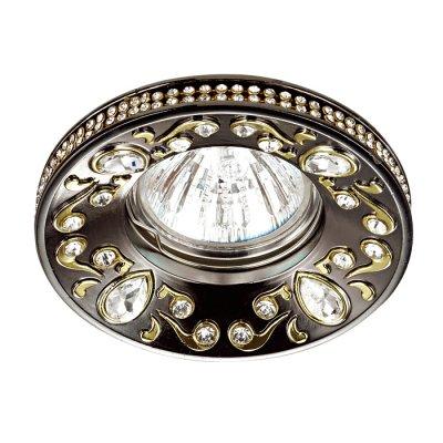 Novotech ERBA 370236 Светильник встраиваемыйКруглые<br>Встраиваемый декоративный светильник модели Novotech 370236 из серии ERBA отличается следующим качеством: Светильник произведен из сплава цинка.  Благодаря сравнительно высоким механическим и литейным качествам, изделия, выполненные из сплава цинка, отличаются высокой точностью деталей декора со сложной конфигурацией. Так же он обладает антикоррозийными свойствами. Декоративные украшения сделаны из хрусталя. Огранка хрусталя, подобно огранке драгоценных камней, позволяет в полной мере проявить свойства, обусловленные большим показателем преломления и дисперсией.<br><br>Тип лампы: галогенная/LED<br>Тип цоколя: gu5.3<br>MAX мощность ламп, Вт: 50<br>Диаметр, мм мм: 96<br>Диаметр врезного отверстия, мм: 75<br>Высота, мм: 27<br>Цвет арматуры: бронзовый