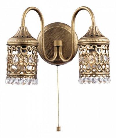 Светильник Odeon light 2641/2Wбра в восточном стиле<br>Благородство и роскошь восточного стиля в освещении непоколебимы! Тому подтверждение богатое убранство настенного бра Odeon light 2641/2W. Оцените по достоинству художественную резку по металлу бронзового мерцания, из которого составлена узорчатая конструкция итальянского шедевра. Корпус представляет собой единение и гармонию каждой части, где основание бра Odeon light 2641/2W мягким изгибом переходит в стилизованный «восточный шатёр» света, украшенный переливающимися каменьями в форме крупных гранул и капель. Это настоящее сокровище для Вашего интерьера, отдельный элемент благородной роскоши в богатом обрамлении, отвечающем за необходимый престиж дома настоящего хозяина.